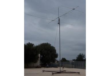 Tubular tower with antenna elevator